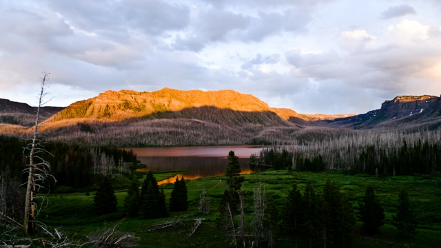 Lake at sunset with mountain alpine glow in the Flat Top Wilderness Area.