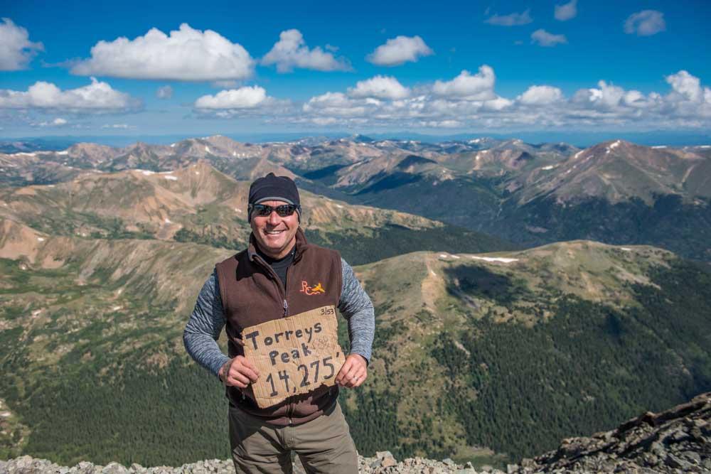 Client climbs Greys and Torreys Peak