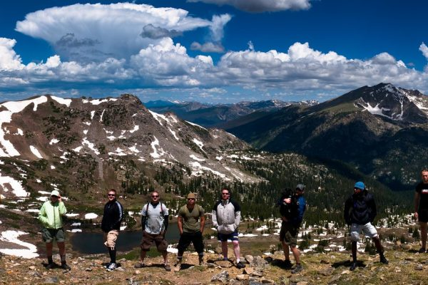 group of hikers with a stunning mountain backdrop