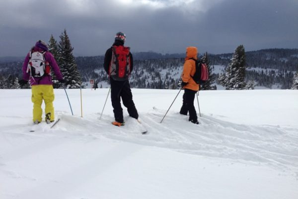 skiers taking in the mountain view