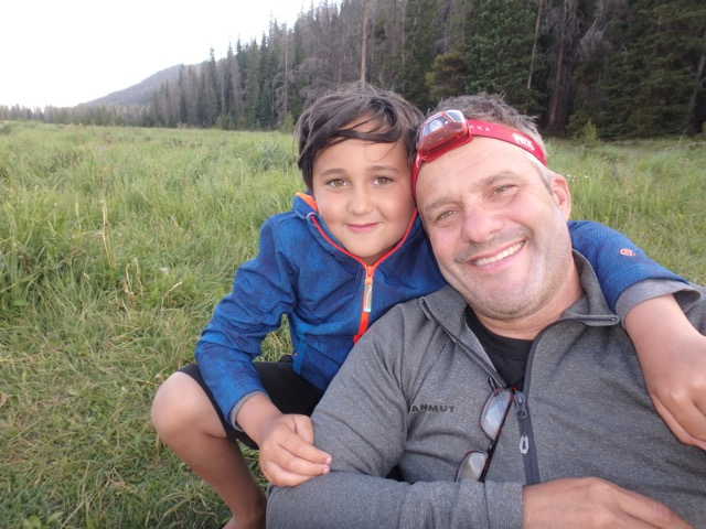 A Happy Dad and Son on a Rocky Mountain National Park Guided Backpacking Trip 2019