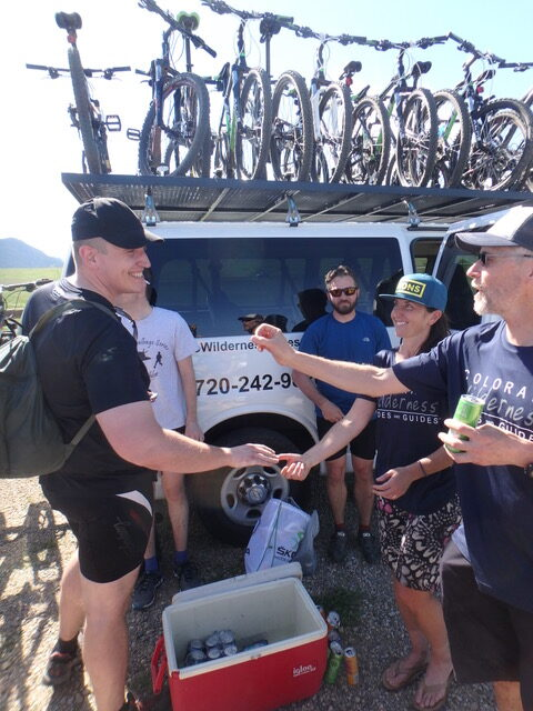 Some Riders Celebrating after a Guided Boulder Mountain Biking Tour with Colorado Wilderness Rides And Guides