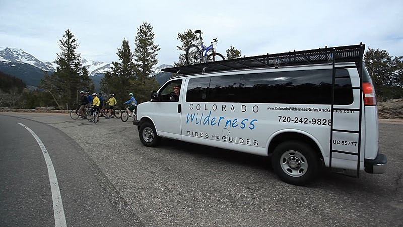 company van dropping off a group of road bikers