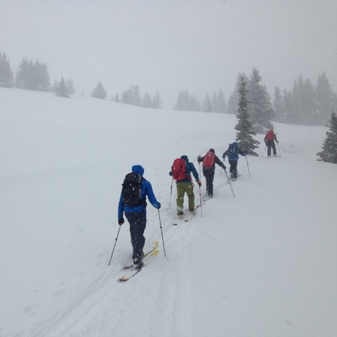 group on skis doing a backcountry tour in the snow
