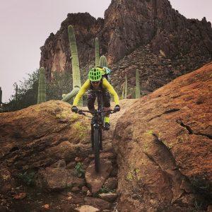 guide Christian Little mountain biking a steep rocky trail