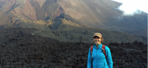 guide Diana Sabreen in a blue jacket on a mountain trail