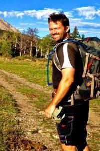guide Joe O'Leary outside on a mountain hiking trail