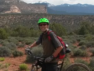 guide Phil Lloyd-Davies outside on his mountain bike