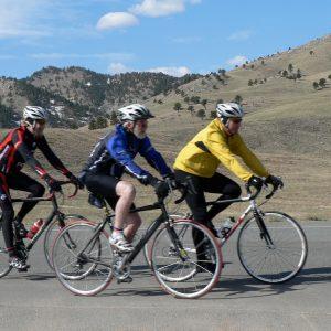 three men on road bikes coasting