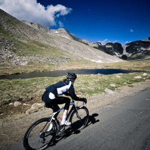 woman riding her road bike up a mountain road