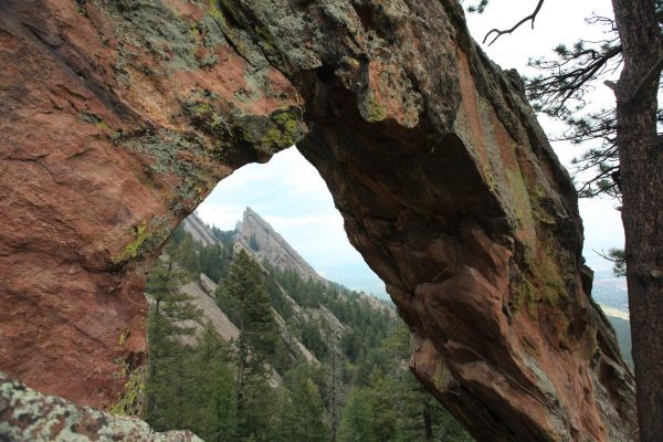 close up of a arch rock foundation on a steep hiking trail