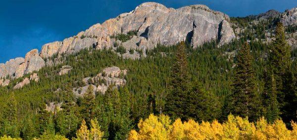 landscape of a mountain ridge with fall foliage