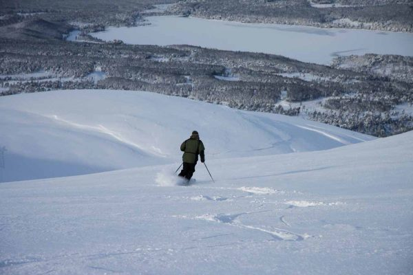 man descending back country skiing