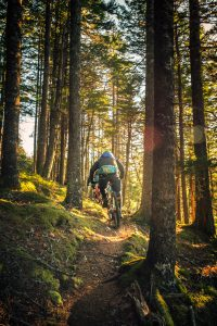 group riding steep forest trails