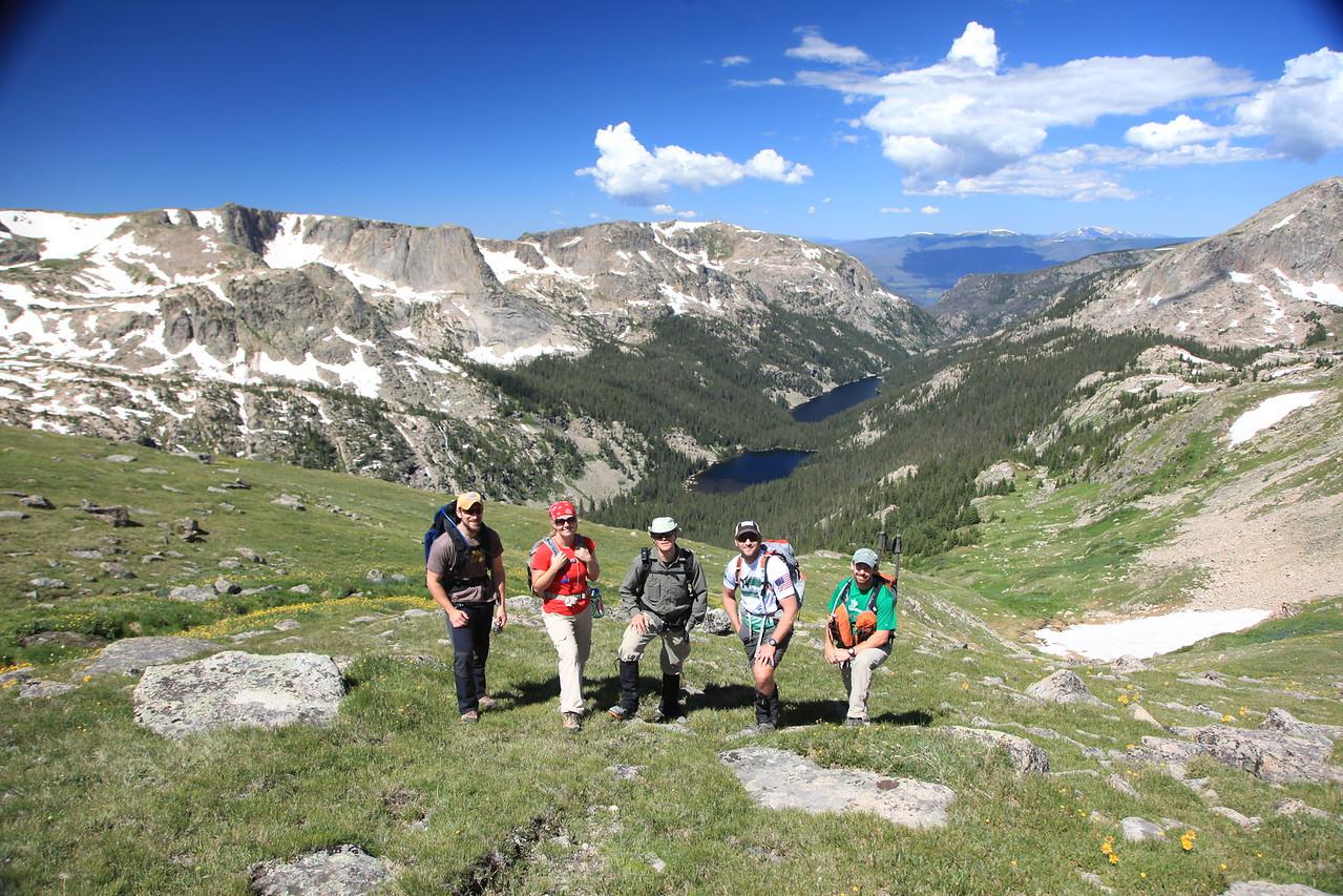 group of hikers enjoying mountain views