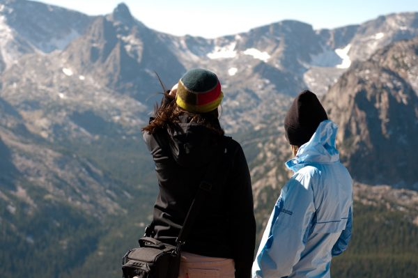 two women on a sightseeing trip taking in the mountain view