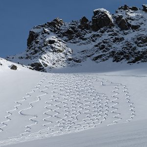 ski descent tracks down a snowy mountain